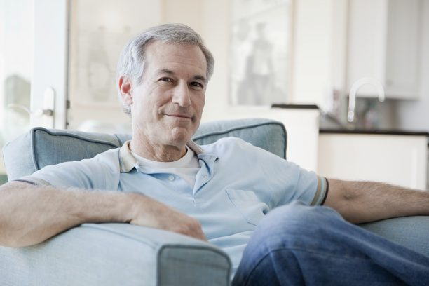 Portrait of senior man in armchair --- Image by © Monalyn Gracia/Corbis